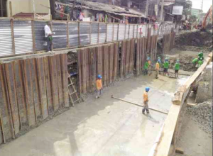 Clearing and construction in Blumentritt for the floodwater interceptor project. Source: http://newsinfo.inquirer.net/files/2014/04/dpwh1.jpg